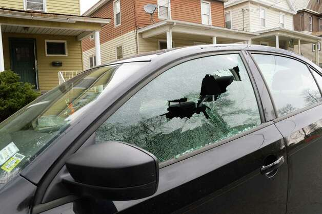 A car with its windows shot out on Eastern Avenue Wednesday April 22, 2015 in Schenectady, NY.  (John Carl D'Annibale / Times Union) Photo: John Carl D'Annibale