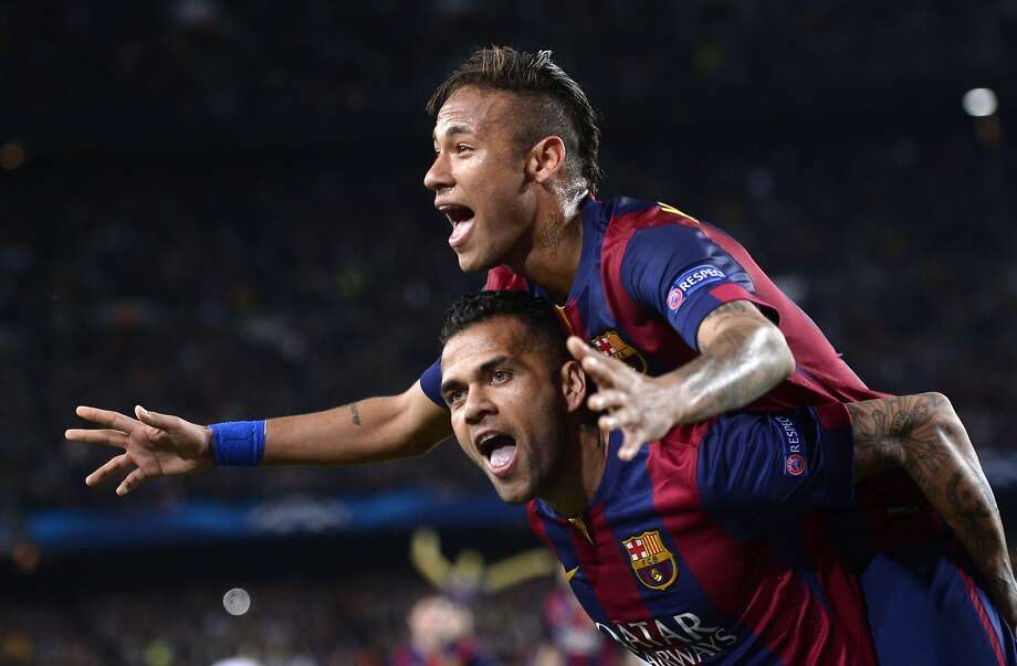 Barcelona's Neymar celebrates on the shoulders of teammate Dani Alves, after scoring his second goal during the Champions League quarterfinal second leg soccer match between FC Barcelona and Paris Saint Germain at the Camp Nou Stadium in Barcelona, Spain, Tuesday, April 21, 2015. (AP Photo/Manu Fernandez) Photo: Manu Fernandez, Associated Press