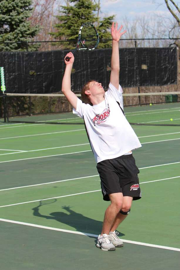 Senior captain and New Canaan native Clay Kontulis serves during St. Luke's match win King on Tuesday. The Storm won the match 4-3. Photo: Contirbuted, Contributed / New Canaan News
