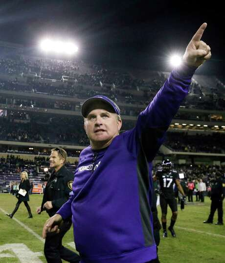TCU head coach Gary Patterson points to fans as he runs off the field after a game against Kansas State in Fort Worth on Nov. 8. 2014. Photo: LM Otero /Associated Press / AP