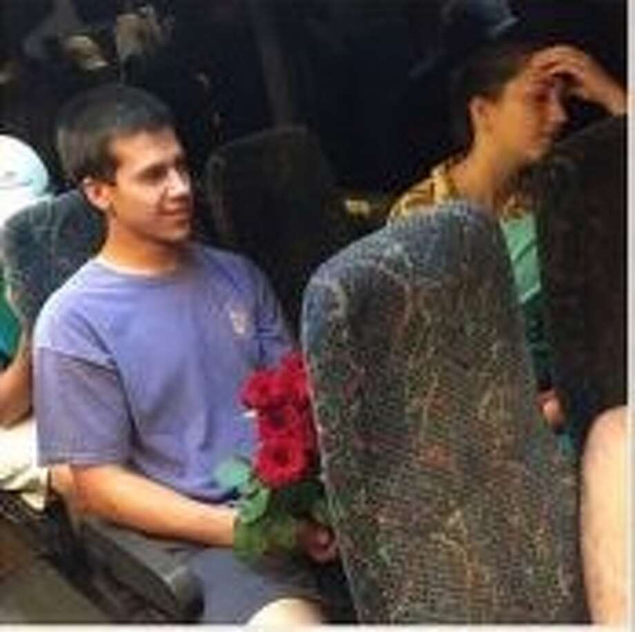 Cody Nichols holding flowers after returning to New Orleans for his date. Photo: Instagram