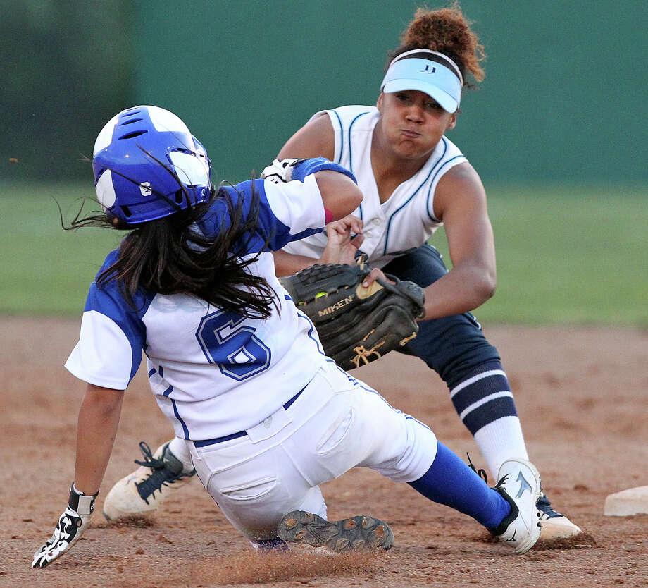 Johnson's Brianna Stefanic tags MacArthur's Emily Trujillo at second base during the Jaguars' victory. Photo: Tom Reel / San Antonio Express-News