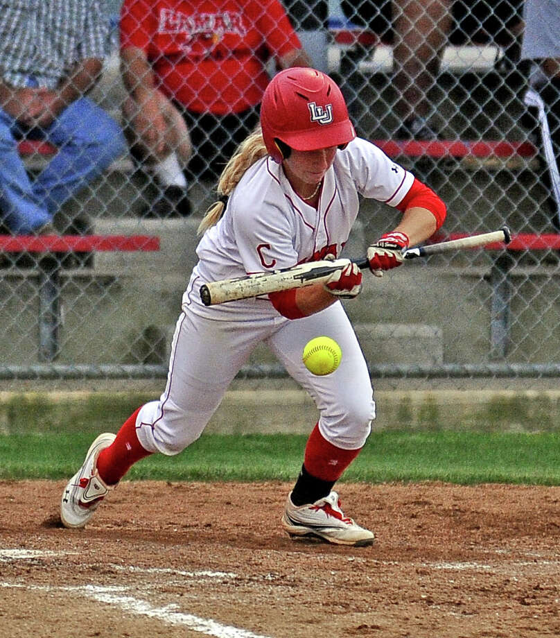 Lamar Lady Cardinal Casey Cromwell, #11, lays down a bunt for a single in the third inning of the Lamar University Lady Cardinals softball game against Texas Souther Lady Tigers on Wednesday, April 17, 2013, at Ford Park.  Photo taken: Randy Edwards/The Enterprise Photo: Randy Edwards