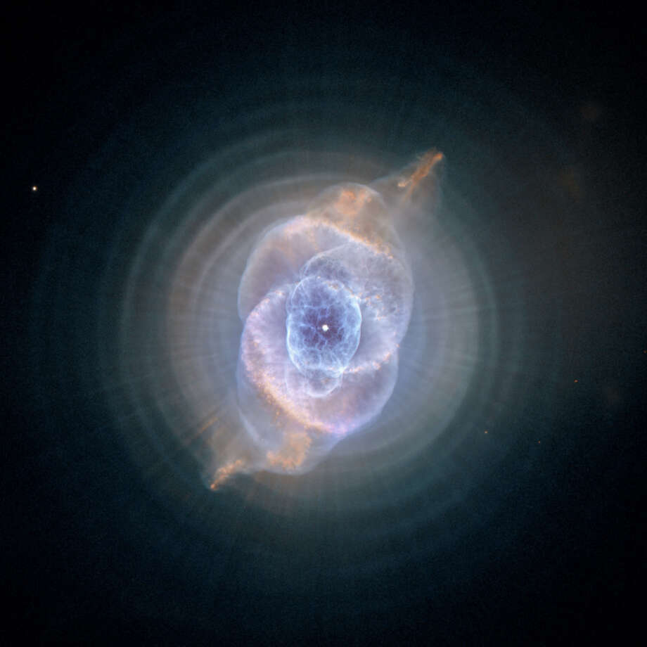 This image made by the NASA/ESA Hubble Space Telescope shows NGC 6543, the Cat's Eye Nebula. A planetary nebula forms when Sun-like stars gently eject their outer gaseous layers that form bright nebulae. In 1994, Hubble first revealed the nebula's surprisingly intricate structures, including concentric gas shells, jets of high-speed gas, and unusual shock-induced knots of gas. The Hubble Space Telescope marks its 25th anniversary. A full decade in the making, Hubble rocketed into orbit on April 24, 1990, aboard space shuttle Discovery.  (NASA, ESA, HEIC, Hubble Heritage Team (STScI/AURA) via AP) ORG XMIT: NY926 Photo: AP / NASA, ESA