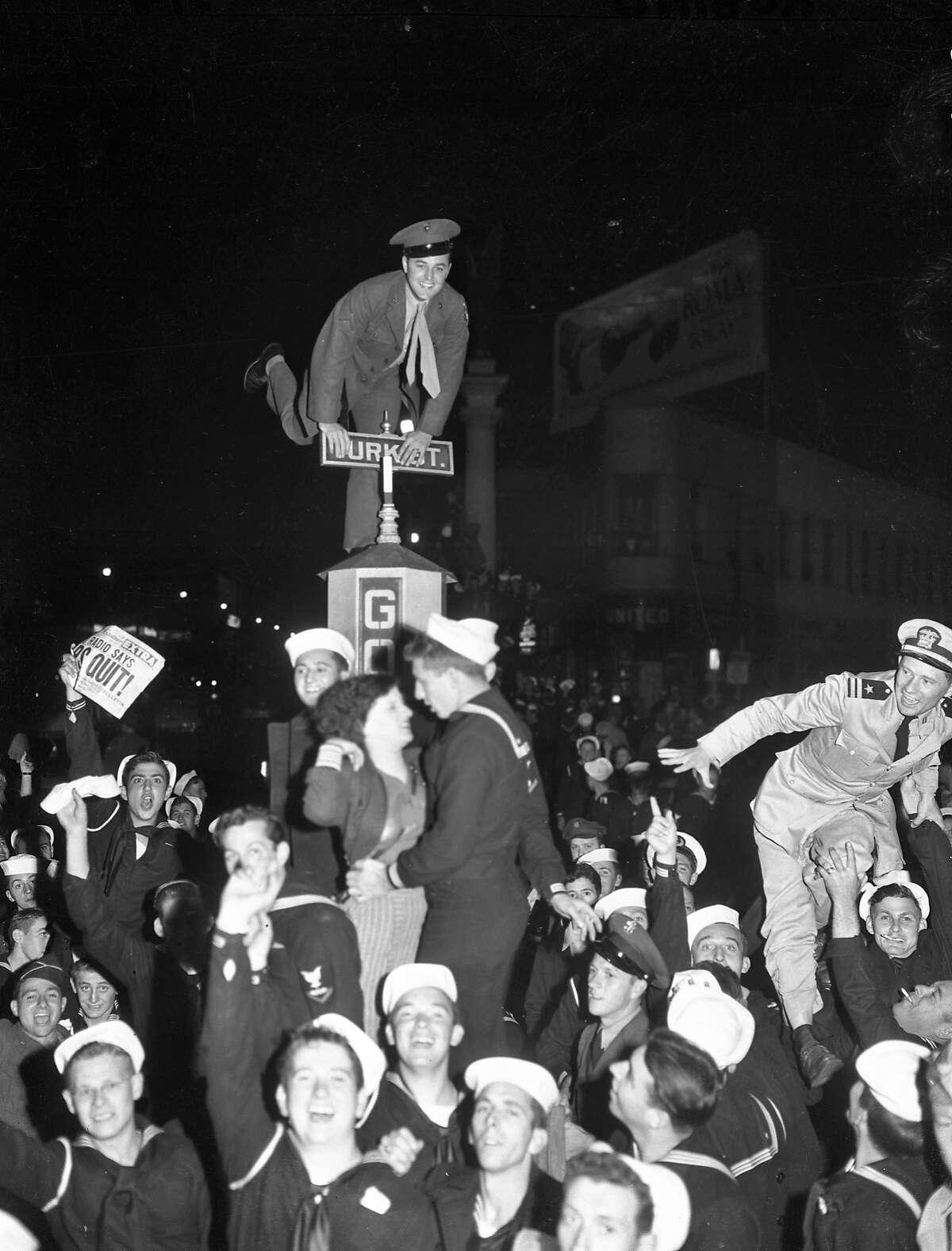 V-J Day celebration in San Francisco ..August 14-15 1945 End of World War II, Japan surrenders Negatives says August 13, 1945, Market Street