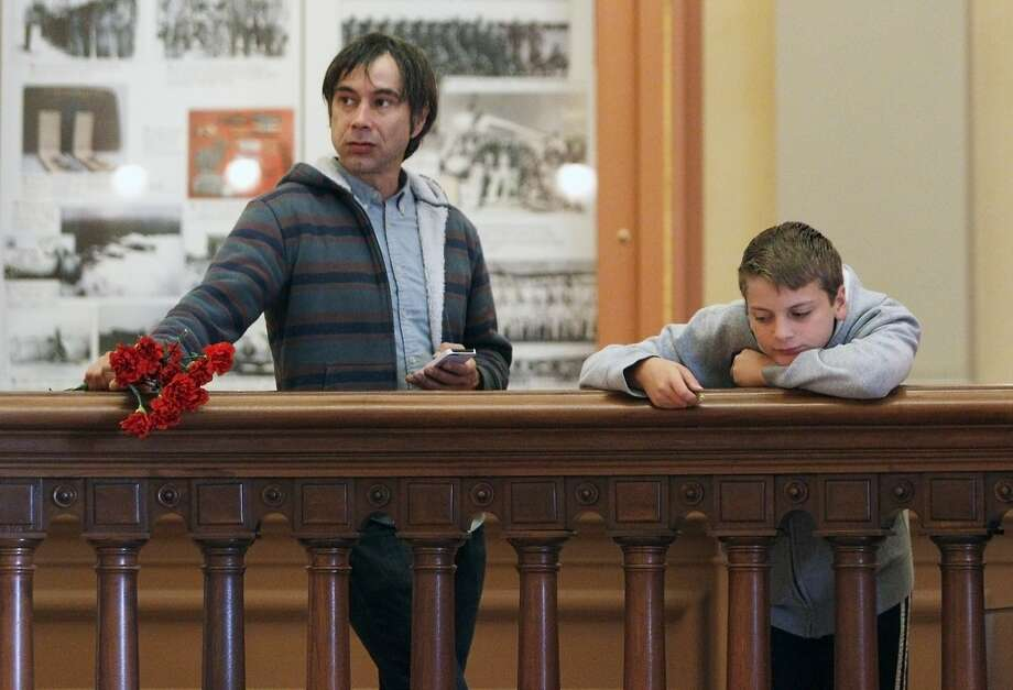 Mark Marthaler (left) of Sonoma and 11-year-old Jacob Lassen of Winsler take a moment following the Senate Education Committee's decision on SB277 at the California State Capitol, Wednesday, April 22, 2015, in Sacramento, Calif. The bill was approved with a 7-2 vote and now goes to the Senate Judiciary Committee. SB277 would eliminate the personal-belief exemption, the option California parents use to skip their childÕs school immunizations, but still allow children to be exempt for medical reasons. Photo: Santiago Mejia, The Chronicle