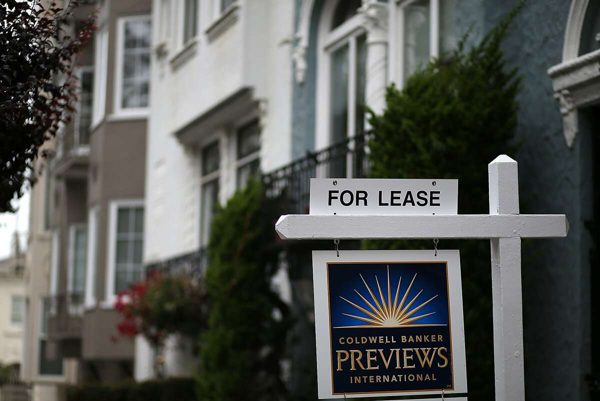 In this file photo, a for lease sign is posted in front of home for rent on April 21, 2015 in San Francisco, California.