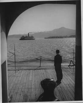 Ferry boats on San Francisco Bay. This was the Richmond to San Rafael run. Seen from the deck of a westward-bound ferry, a boats steams out of slip at Point San Quentin, docking point for the San Rafael side.  Photo by James M Morley.