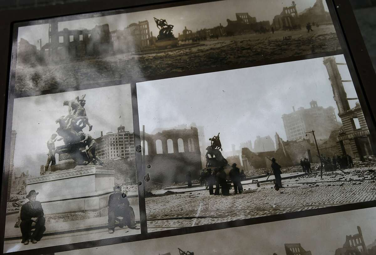 Photographs taken just after the 1906 earthquake show the Donahue mechanics monument still standing in the debris. The photos are displayed in the plaza area Wednesday April 22, 2015. Jim Delgado, San Francisco historian and adventurer, visits the Mechanics Monument Plaza on Market Street.