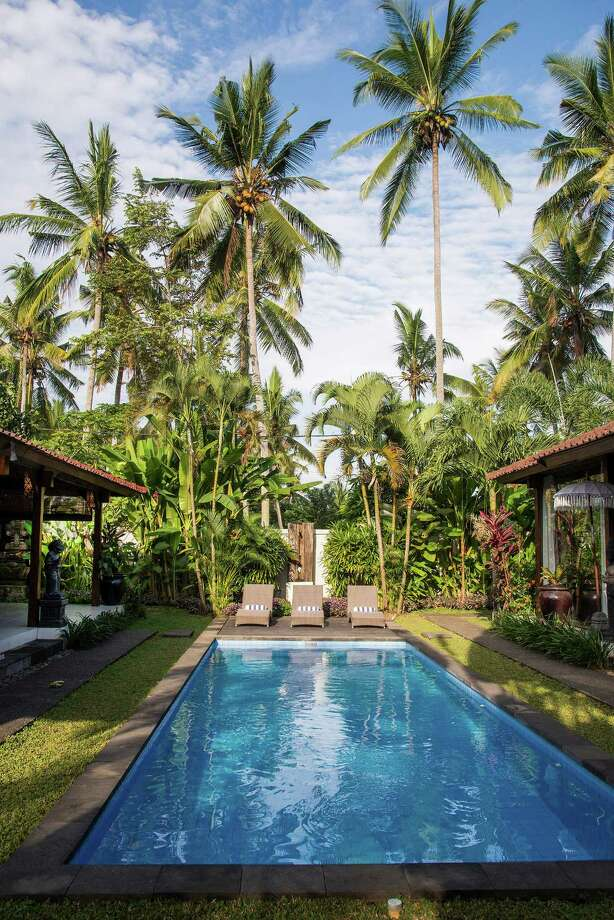 A pool separates the two two traditional joglo structures of a 3,300-square-foot home on the market for $435,000 in Ubud, on Bali in Indonesia, April 18, 2015. Joglos are simple, open-air, buildings made from wood beams — those here are more than 120 years old and were originally used at a train station on neighboring Java. Photo: Rony Zakaria/The New York Times / NYTNS