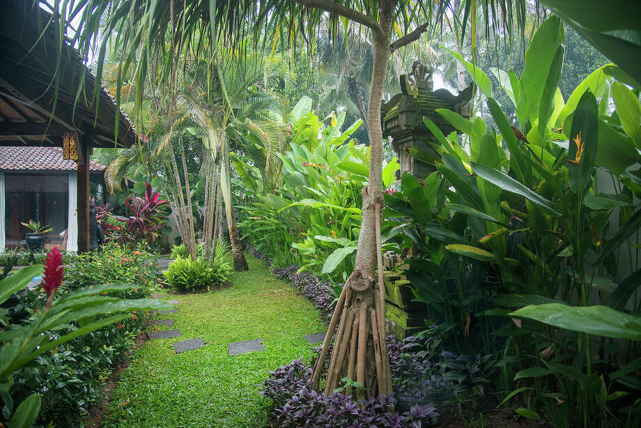 Statue-filled gardens surround a traditional 3,300-square-foot home on the market for $435,000 in Ubud, on Bali in Indonesia, April 18, 2015. The home sits on a fifth of an acre of land and is comprised of two joglos, the simple, open-air, Javanese buildings made from wood beams. Photo: Rony Zakaria/The New York Times / NYTNS