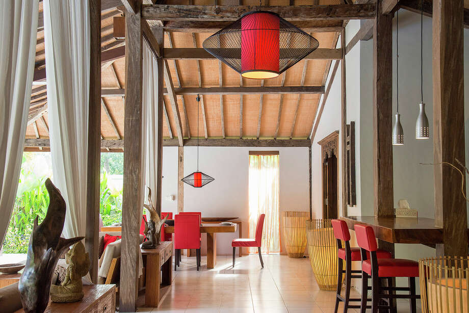 An open living area, dining area and kitchen in the larger of two structures comprising a 3,300-square-foot home on the market for $435,000 in Ubud, on Bali in Indonesia, April 18, 2015. The simple, open-air, buildings made from wood beams are known as joglos in Java. Photo: Rony Zakaria/The New York Times / NYTNS