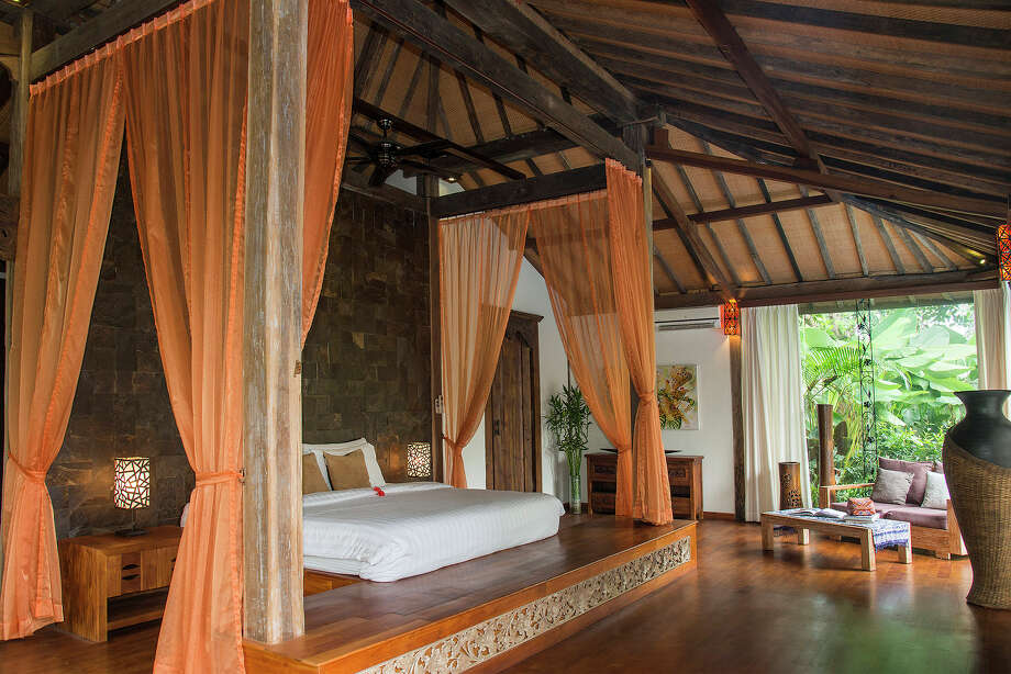 A king-size bed on a pedestal raised from the teak floors of the master bedroom in a 3,300-square-foot home on the market for $435,000 in Ubud, on Bali in Indonesia, April 18, 2015. The home is comprised of two joglos, the simple, open-air, Javanese buildings made from wood beams. Photo: Rony Zakaria/The New York Times / NYTNS