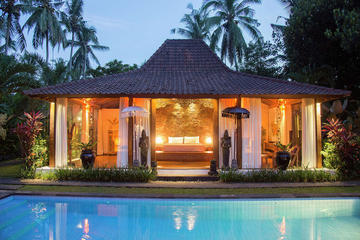 The smaller of two traditional joglo structures serves as the master bedroom of a 3,300-square-foot home on the market for $435,000 in Ubud, on Bali in Indonesia, April 18, 2015. Joglos are simple, open-air, buildings made from wood beams - these are more than 120 years old and were originally used at a train station on neighboring Java.