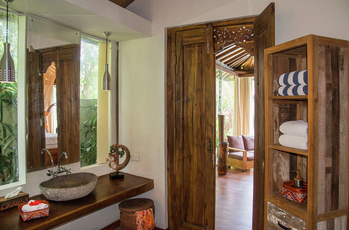 A private bath adjoining the master suite of a 3,300-square-foot home on the market for $435,000 in Ubud, on Bali in Indonesia, April 18, 2015. The home is comprised of two joglos, the simple, open-air, Javanese buildings made from wood beams.