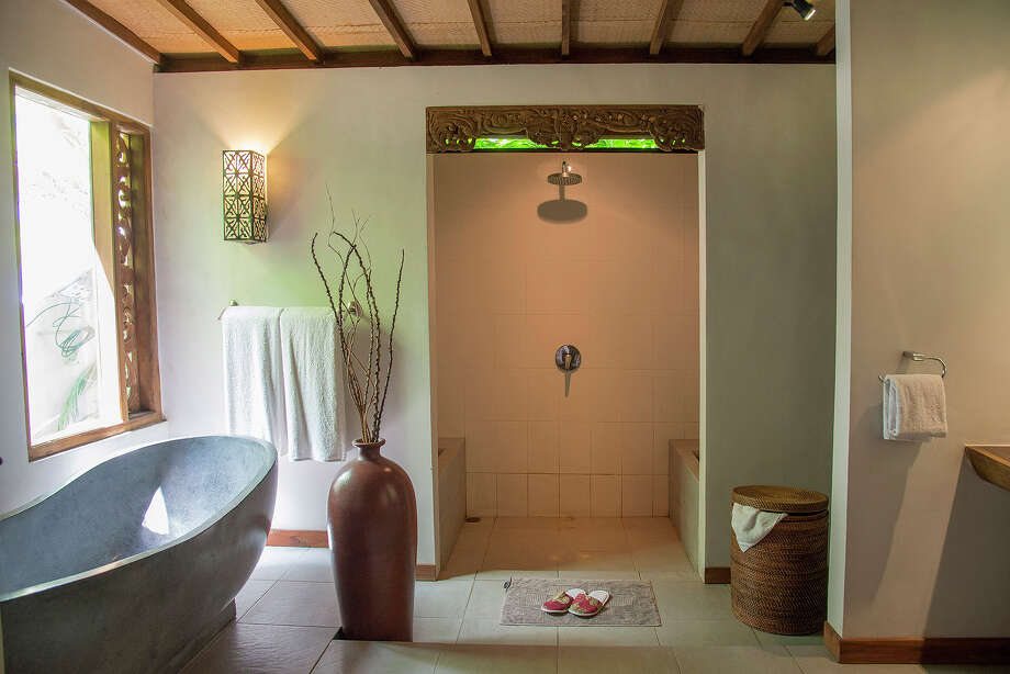 A bathroom with a stone tub, in a traditional 3,300-square-foot home on the market for $435,000 in Ubud, on Bali in Indonesia, April 18, 2015. The home, two traditional Javanese-style joglo structures separated by a pool, has air conditioned bedrooms while the rest of the home is fan-cooled. Photo: Rony Zakaria/The New York Times / NYTNS