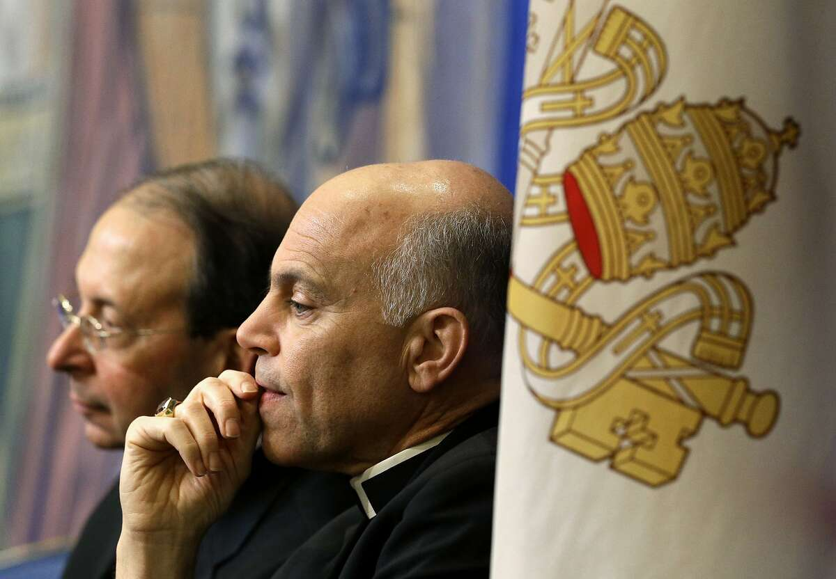 FILE - In this Nov. 12, 2012 file photo, Archbishop Salvatore Cordileone of San Francisco, center, and Archbishop William Lori, of Baltimore, listen to a speaker during the United States Conference of Catholic Bishops' annual fall meeting in Baltimore.