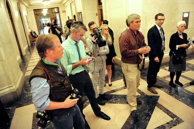 Members of the media wait patiently for Sen. Dean Skelos to emerge from his office on Tuesday, April 21, 2015, at the Capitol in Albany, N.Y. (Cindy Schultz / Times Union) Photo: Cindy Schultz, Albany Times Union / 00031554A