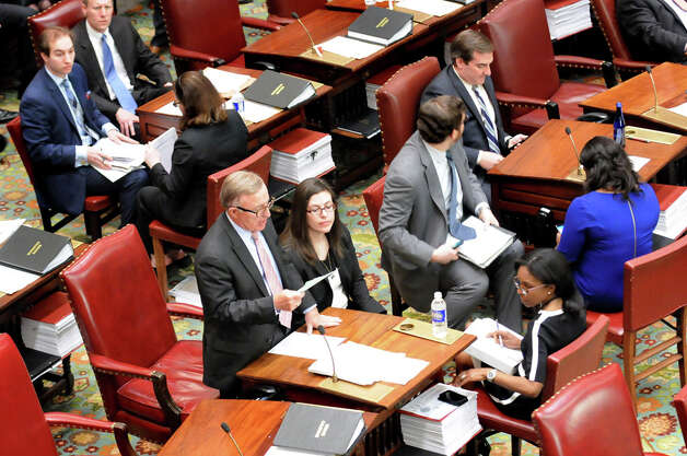 Sen. John A. DeFrancisco, center, takes charge in the absence of Sen. Dean Skelos on Tuesday, April 21, 2015, at the Capitol in Albany, N.Y. (Cindy Schultz / Times Union) Photo: Cindy Schultz, Albany Times Union / 00031554A