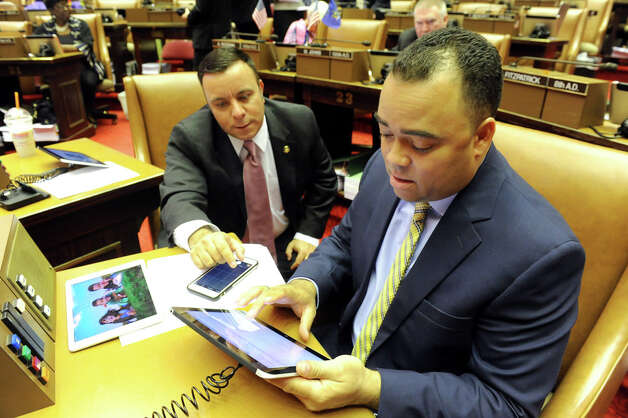 Assembly freshmen Erik Dilan (Dem.), right, and Karl Brabenec (Rep.) show bi-partisanship as they learn the new tablet system in the Assembly Chamber on Wednesday, April 22, 2015, at the Capitol in Albany, N.Y. (Cindy Schultz / Times Union) Photo: Cindy Schultz, Albany Times Union / 00031574A