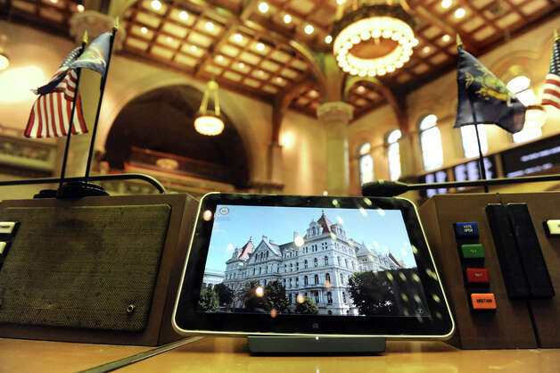 Tablets are tethered to each desk in the Assembly Chamber on Wednesday, April 22, 2015, at the Capitol in Albany, N.Y. (Cindy Schultz / Times Union) Photo: Cindy Schultz, Albany Times Union / 00031574A