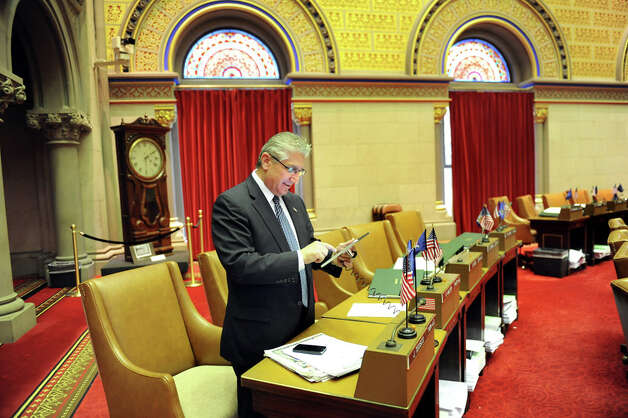 Assemblyman Jim Tedisco gets familiar with the new tablets in the Chamber on Wednesday, April 22, 2015, at the Capitol in Albany, N.Y.  The Assembly will use the tablets for the first time on Earth Day in place of paper bills. (Cindy Schultz / Times Union) Photo: Cindy Schultz, Albany Times Union / 00031574A