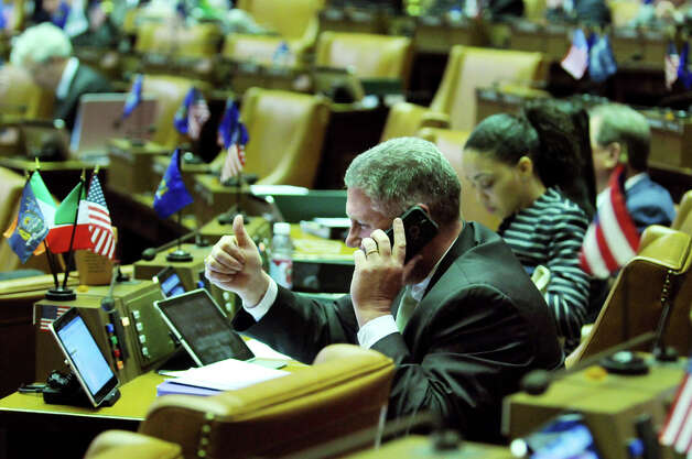Assemblyman John T. McDonald III solves a problem with the new tablet via the help desk in the Assembly Chamber on Wednesday, April 22, 2015, at the Capitol in Albany, N.Y. (Cindy Schultz / Times Union) Photo: Cindy Schultz, Albany Times Union / 00031574A