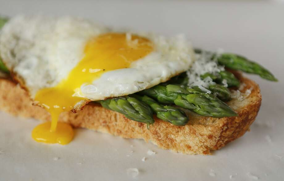 Asparagus and Eggs on Toast is seen on Wednesday, April 22, 2015 in San Francisco, Calif. Photo: Russell Yip, The Chronicle