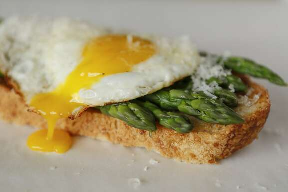 Asparagus and Eggs on Toast is seen on Wednesday, April 22, 2015 in San Francisco, Calif.