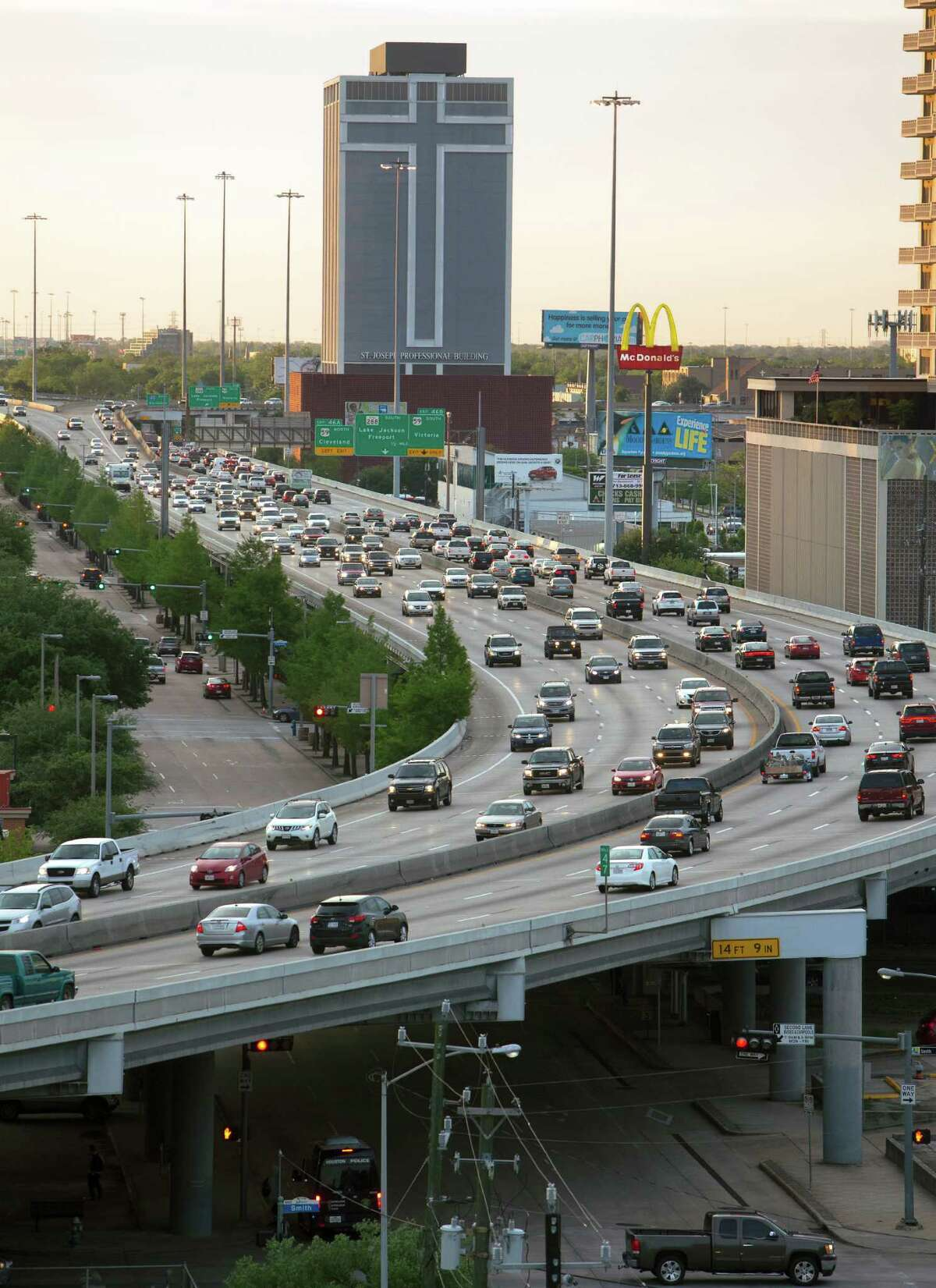 Traffic travels along the Pierce Elevated, Monday, April 20, 2015, in Houston.