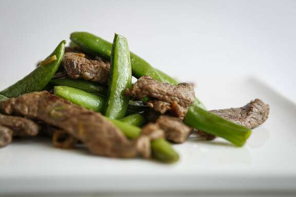 Steak and spring vegetable saute is seen on Wednesday, April 22, 2015 in San Francisco, Calif.