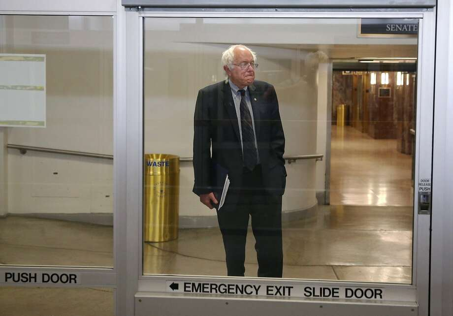 "Sen. Bernie Sanders waits for the Senate subway to the Capitol. Sanders gave an impassioned speech denouncing the ""fast track"" trade legislation. Photo: Mark Wilson, Getty Images"