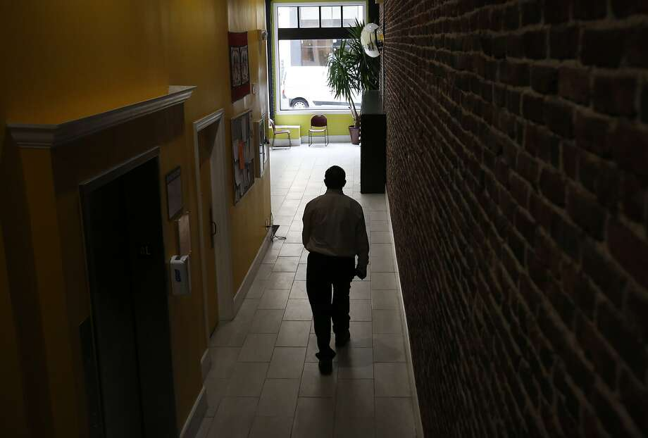 Kevin Chenevert, 57, walks towards the building's lobby where he sometimes likes to hang out, in an apartment complex that provides permanent housing for homeless veterans on 250 Kearny April 22, 2015 in San Francisco, Calif. Photo: Leah Millis, The Chronicle