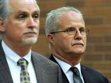Brookfield's former school finance director Art Colley, right, appears last month in Superior Court in Danbury, Conn., alongside his attorney, Eugene Riccio. Colley has been charged with second-degree larceny and third-degree forgery after police said he tried to claim reimbursement for three iPads he never purchased.