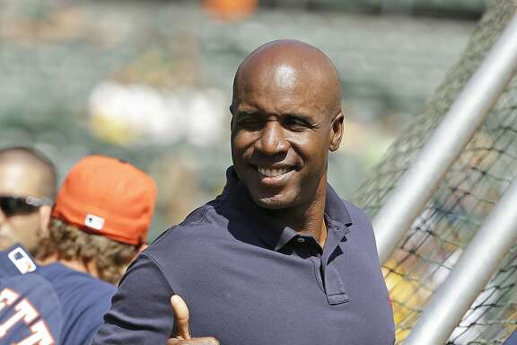 File - In this Sept. 6, 2014, file photo, career home run leader Barry Bonds gives a thumbs up while standing behind the batting cage and watching the Houston Astros take batting practice before the start of a baseball game against the Oakland Athletics in Oakland, Calif. Bonds' obstruction of justice conviction reversed by 9th US Circuit Court of Appeals on Wednesday, April 22, 2015. (AP Photo/Eric Risberg, File)