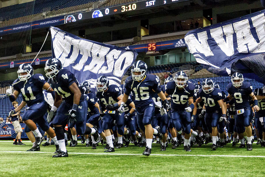 The Smithson Valley Rangers take the field prior to their 4A Division I second-round football playoff game with Austin Lake Travis at the Alamodome on Nov. 18, 2011. Photo: Marvin Pfeiffer /San Antonio Express-News / Express-News 2011