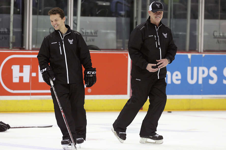 San Antonio Rampage head coach Tom Rowe (right) and assistant coach Scott Allen go through team practice at the AT&T Center on April 21, 2015. They are a big reason the franchise finds itself back in the playoffs for the first time in a while. Rowe apparently is a big fan of Spurs coach Gregg Popovich, and tries to model how he handles his team after Pop. Photo: Jerry Lara /San Antonio Express-News / © 2015 San Antonio Express-News