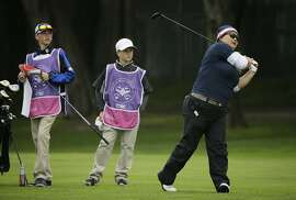 Christina Kim follows her shot from the fairway to the ninth green of the Lake Merced Golf Club during the pro-am event of the Swinging Skirts LPGA Classic golf tournament Wednesday, April 22, 2015, in Daly City, Calif. (AP Photo/Eric Risberg)