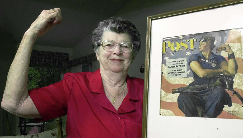 Mary Doyle Keefe poses in 2002 at her home in Nashua, N.H., with the May 29, 1943, Saturday Evening Post cover featuring the Norman Rockwell painting for which she had modeled. Photo: Associated Press / AP