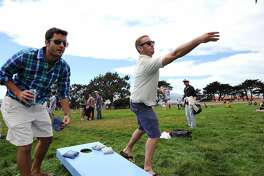 James G. and Aaron Alcorn, right, play a game of corn hole with friends at the Fort Mason Great Meadow in San Francisco, California, Saturday August 17, 2013.
