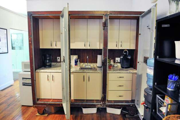 An old office safe is converted to a kitchenette in the new offices of Groff NetWorks on 4th St. Thursday April 16, 2015 in Troy, NY.  (John Carl D'Annibale / Times Union) Photo: John Carl D'Annibale / 00031451A