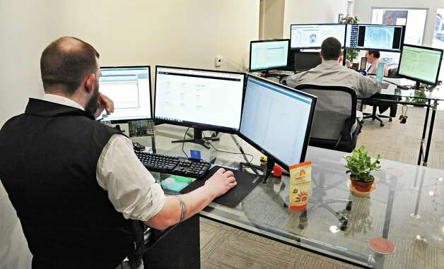 Service desks in the think tank at the new offices of Groff NetWorks Thursday April 16, 2015 in Troy, NY.  (John Carl D'Annibale / Times Union) Photo: John Carl D'Annibale / 00031451A