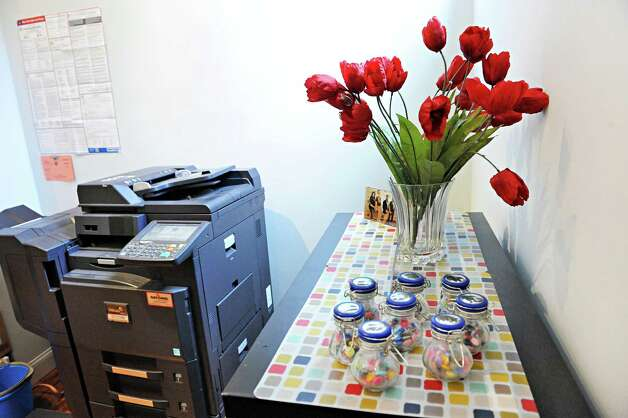 Copy station with flowers in the new offices of Groff NetWorks on 4th St. Thursday April 16, 2015 in Troy, NY.  (John Carl D'Annibale / Times Union) Photo: John Carl D'Annibale / 00031451A