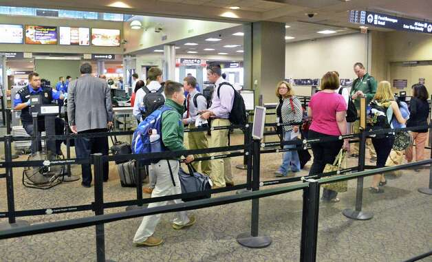 Travelers queue up for security screening at Albany International Airport Wednesday April 22, 2015 in Colonie, NY.  (John Carl D'Annibale / Times Union) Photo: John Carl D'Annibale / 00031576A