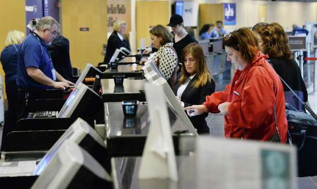 Travelers at the ticket counters at Albany International Airport Wednesday April 22, 2015 in Colonie, NY.  (John Carl D'Annibale / Times Union) Photo: John Carl D'Annibale / 00031576A