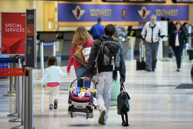 Travelers at Albany International Airport Wednesday April 22, 2015 in Colonie, NY.  (John Carl D'Annibale / Times Union) Photo: John Carl D'Annibale / 00031576A