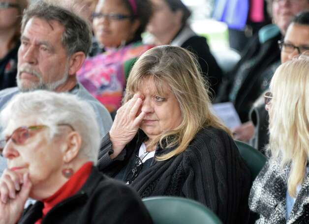 Diane Spencer of Glenville wipes a tear for her daughter Jennifer Marie Fake during the annual Ceremony of Remembrance of Homicide Victims in Central Park Wednesday April 22, 2015 in Schenectady, NY.  (John Carl D'Annibale / Times Union) Photo: John Carl D'Annibale / 00031493A