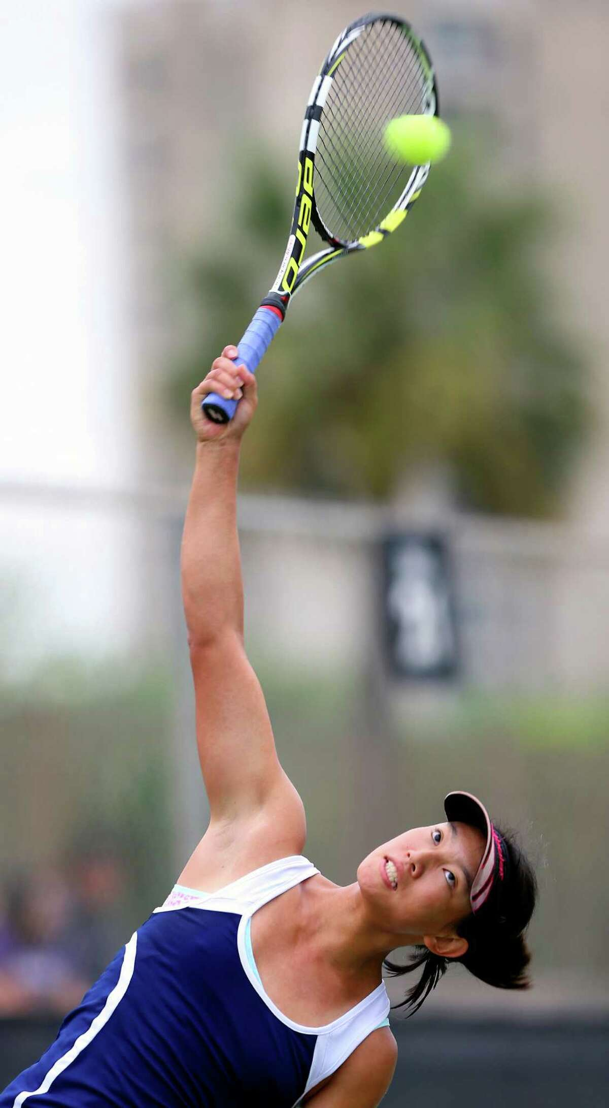 Chuyang Guan competes Wednesday April 22, 2015 at the McFarland Tennis Center in the Region IV-6A tennis tournament. She won her match against Beatriz Benavides 6-0, 6-3.