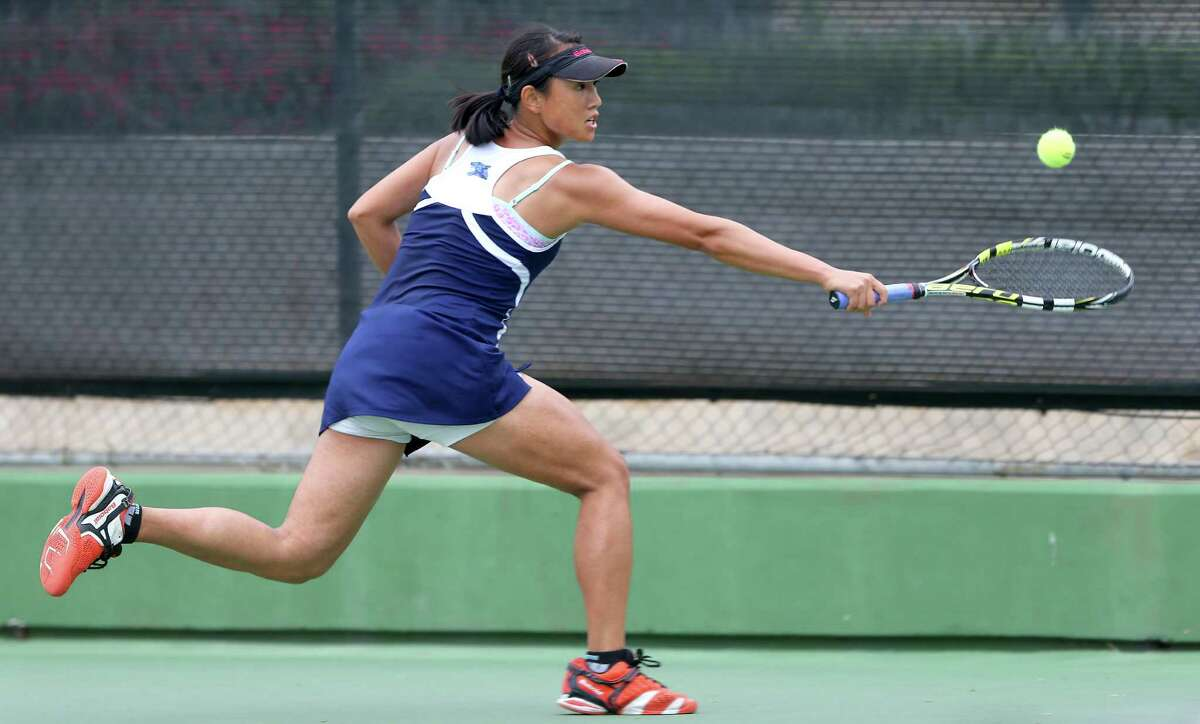 Johnson's Chuyang Guan reaches for a backhand during her victory over Laredo Alexander's Beatriz Benavides. She later lost the final to New Braunfels' Sammi Gillas but still reached state.