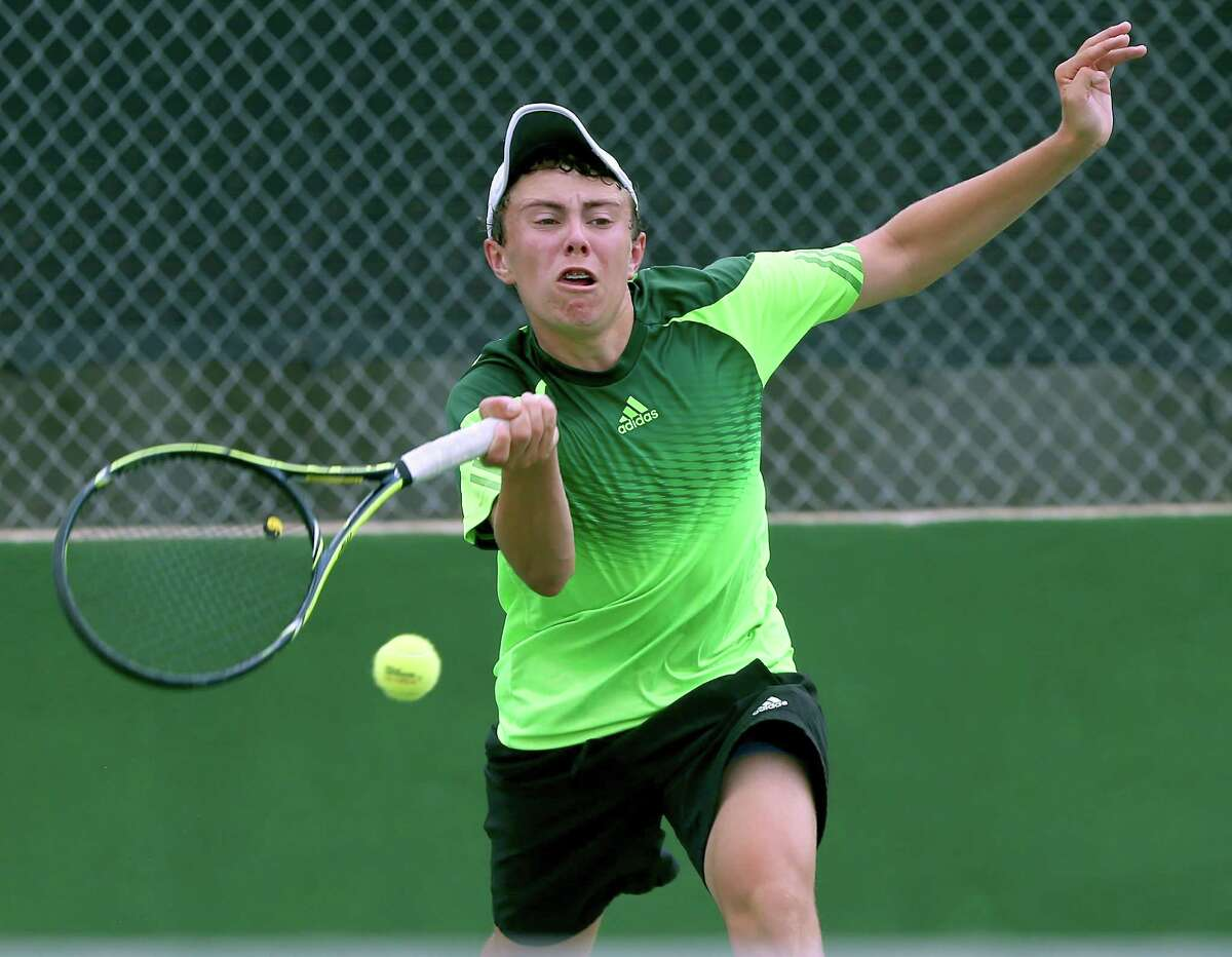 Reagan's Eddie Ayers competes April 22, 2015 at the McFarland Tennis Center in the Region IV-6A tennis tournament against Gabriel Burundi. Ayers won 6-1, 7-6 (1). Ayers is the Express-News boys tennis player of the year.